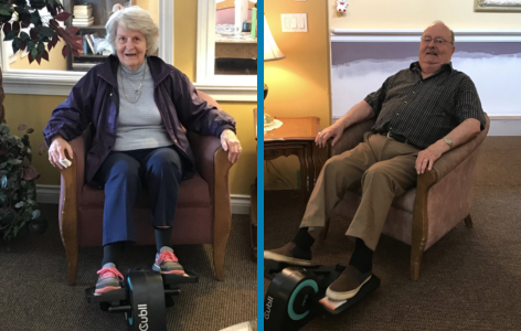 Two Optima Living residents enjoying the Cubii compact seated elliptical