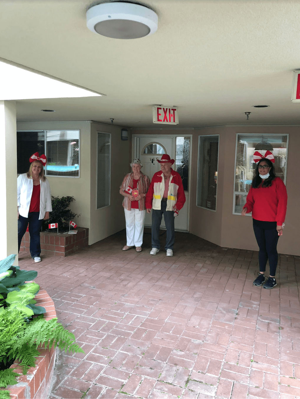 Maureen Fakaro and Gurpreet Pannu, the Community Relations team at Wisteria Place, with prospective residents celebrating Canada Day with physical distancing.